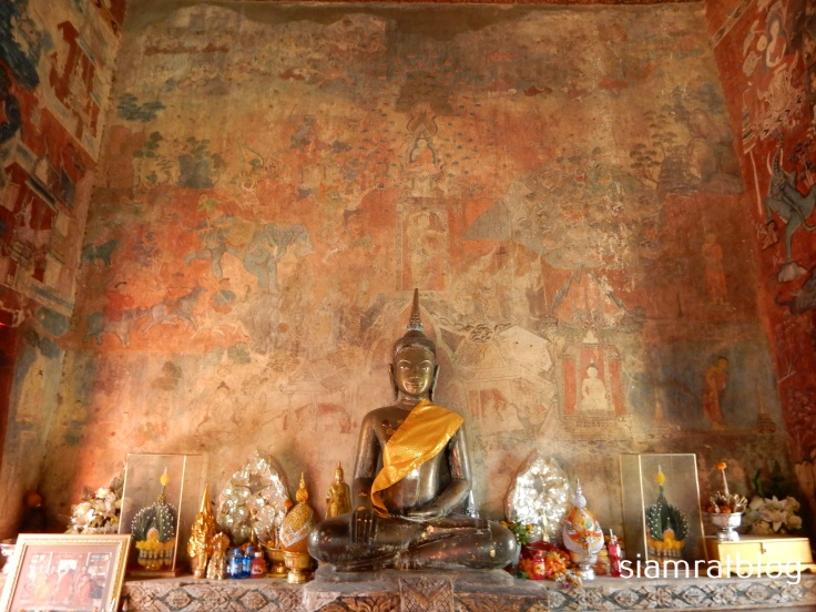 buddha statue and mural