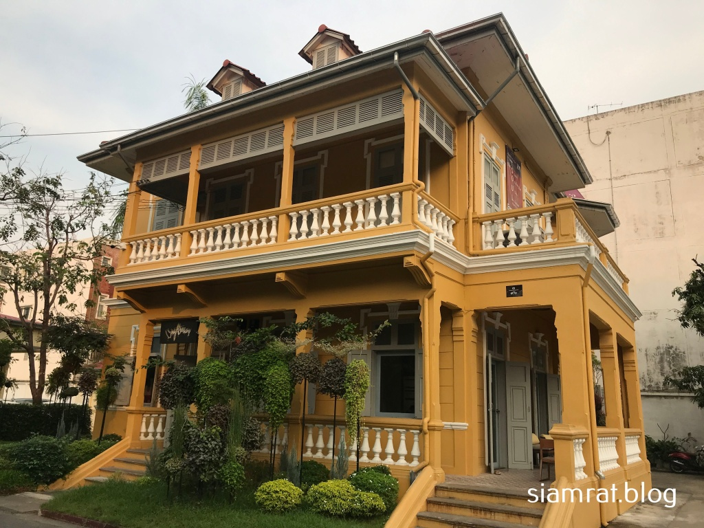 two storey yellow house